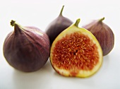 Halved fig in front of whole figs