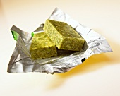 Two stock cubes on aluminium foil