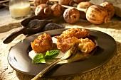 Deep-fried potato dumplings with poppyseed cream sauce