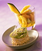 Yoghurt & lime mousse with grated coconut and kiwi slices