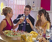Young people drinking a toast in champagne