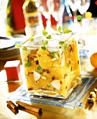 Orange and apple salad with ice cubes