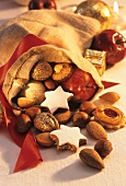 Biscuits, nuts and apple in Santa's sack