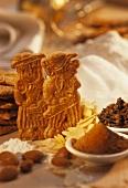 Shaped biscuits (Spekulatius) with baking ingredients
