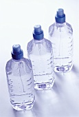 Three bottles of oxygenated mineral water