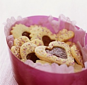 Heart-shaped biscuits with raspberry jam