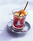 A cup of hot sangria in Christmassy cup