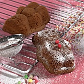 Freshly baked bears in dark sponge mixture