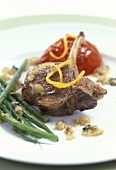 Lamb cutlet with green beans and tomatoes