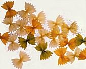 Coloured farfalle with flour