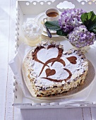 Heart-shaped chocolate gateau with vanilla mascarpone cream