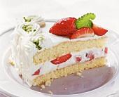 A piece of white strawberry truffle gateau