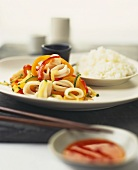 Squid rings with peppers, sweet and sour