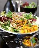 Barbecued veal escalope with mango salsa and lettuce