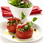 Stuffed tomatoes with rice, capers and dried tomatoes