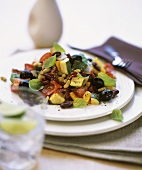 Warm vegetable salad with courgettes, beans & black olives