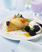 A piece of pear and blackberry cake