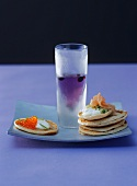 Blinis with caviare & salmon & a glass of blueberry vodka