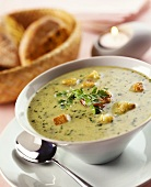 Lettuce soup with garlic croutons