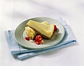 Two pieces of cheesecake with raspberries