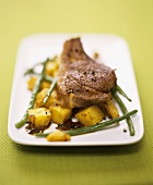 Lamb chops with curried potatoes and green beans