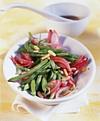 Green bean salad with red onions and pine nuts