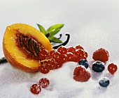 Still life with sugar, berries, peach and vanilla pod