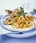 Curried shrimps with naan bread