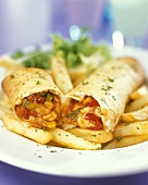 Wraps with chicken and vegetable filling and chips