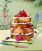 Multi-tiered berry gateau decorated with flowers