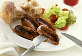 British sausages with lettuce and bread