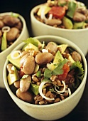 Lukewarm bean salad with spelt and avocado