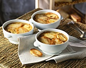 Onion soup with toasted baguette slices