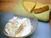 Cream cheese, a piece of cream cheese tart behind