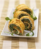 Omelette roulade with asparagus and carrot filling