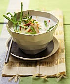 Coconut soup with asparagus and crab