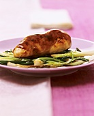 Chicken breast with soya vanilla sauce on spring onions