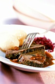 Braised pickled beef with raisins