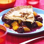 A piece of cherry and mango pie