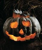 Halloween pumpkin in hay