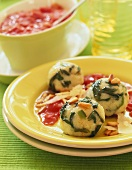 Spinach dumplings with tomato sauce
