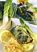 Chard and fish rolls with white sauce and rice