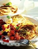 Sweet pancakes with fruit salad