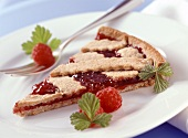 A piece of classic Linzer tart (with raspberry jam)