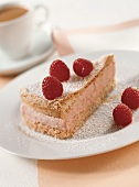 A piece of buckwheat cake with raspberry mousse