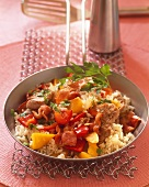 Pan-cooked peppers and rice with pork and bacon