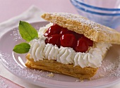 Puff pastry slices with cherry and cream filling