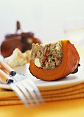 A piece of squash with mince stuffing
