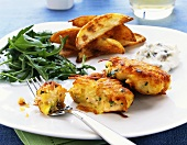 Salmon & potato cakes with rocket, potato wedges & dip