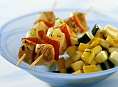 Baked turkey and pepper kebabs with braised courgettes